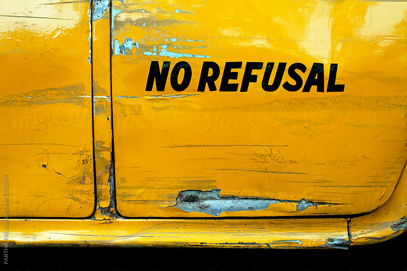 NO REFUSAL written on a yellow colored taxi by PARTHA PAL for Stocksy United