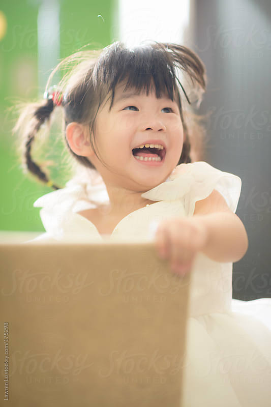 girl jumping and laughing heartily by Lawren Lu for Stocksy United