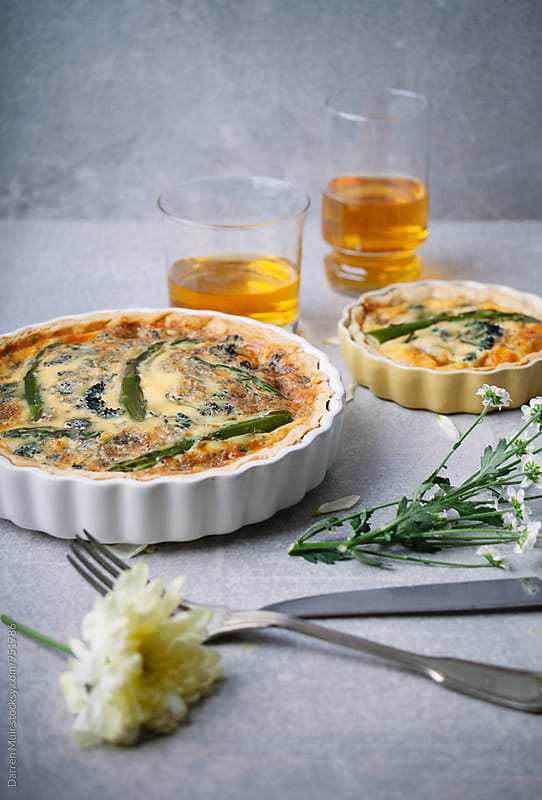 Asparagus, broccoli and blue cheese quiche. by Darren Muir for Stocksy United