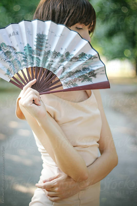Portrait of a beautiful young female with lady fan by Branislava Živić for Stocksy United