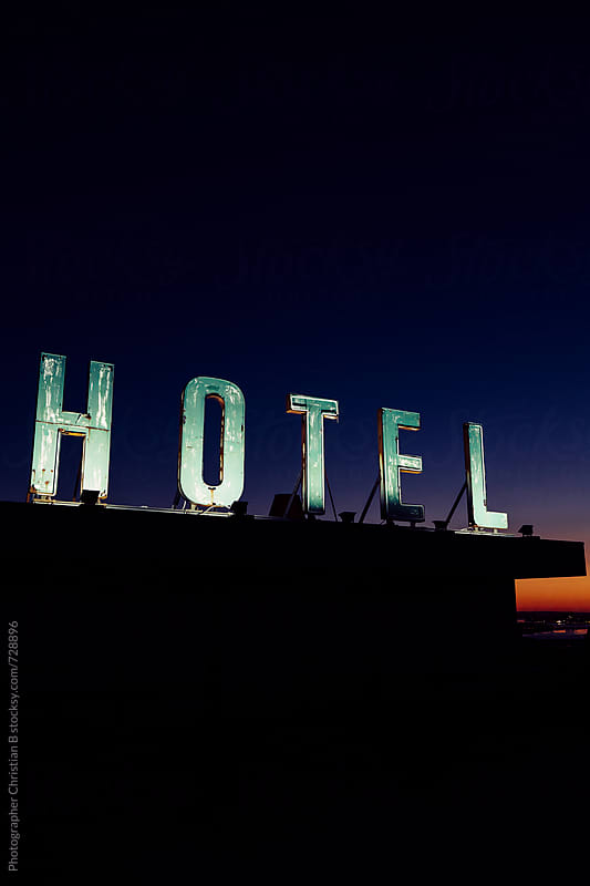 Old hotel sign on a roof by Photographer Christian B for Stocksy United