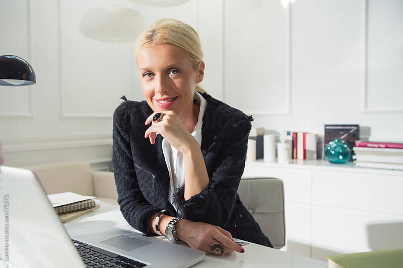Smiling Businesswoman Working at Her Laptop by Lumina for Stocksy United