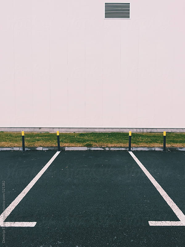 Empty parking space by Dimitrije Tanaskovic for Stocksy United
