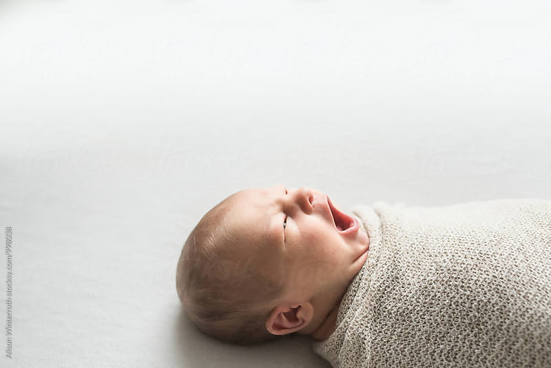 Profile of Baby Yawning by Alison Winterroth for Stocksy United