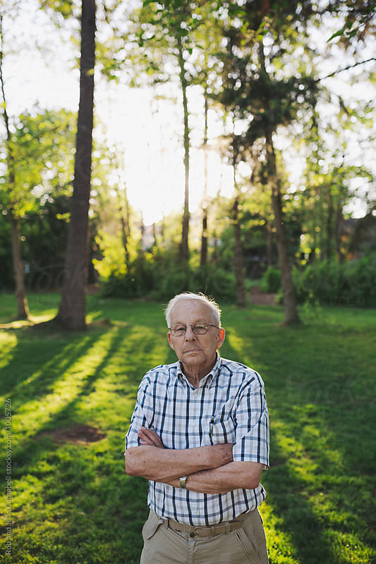 Serious portrait of senior man outside by Rob and Julia Campbell for Stocksy United
