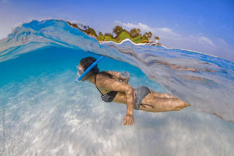 Woman snorkeling by Felix Hug for Stocksy United