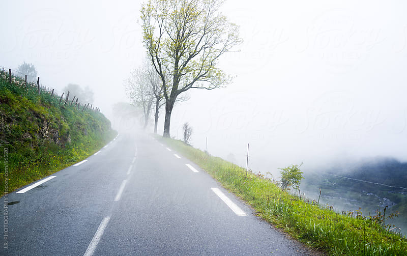 Mountain road in the foggy morning by J.R. PHOTOGRAPHY for Stocksy United
