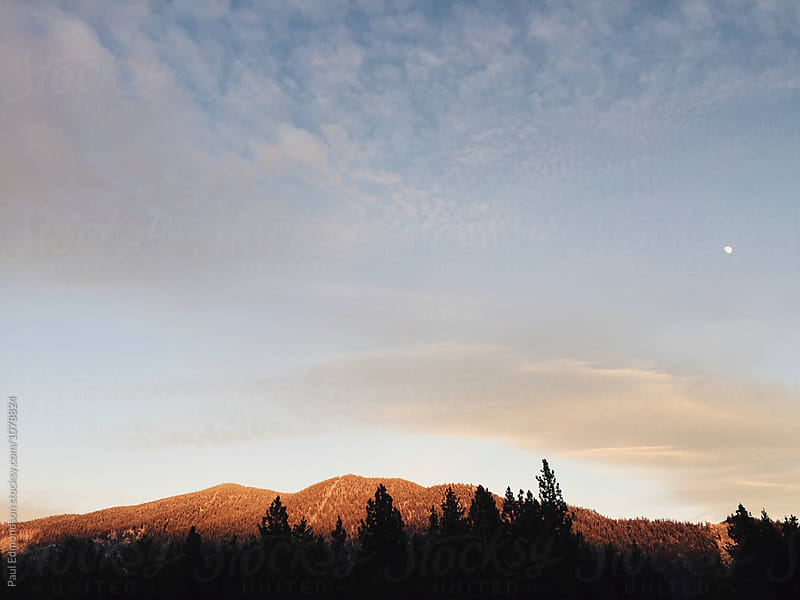 Sunset over mountains, High Sierra, South Lake Tahoe, CA by Paul Edmondson for Stocksy United