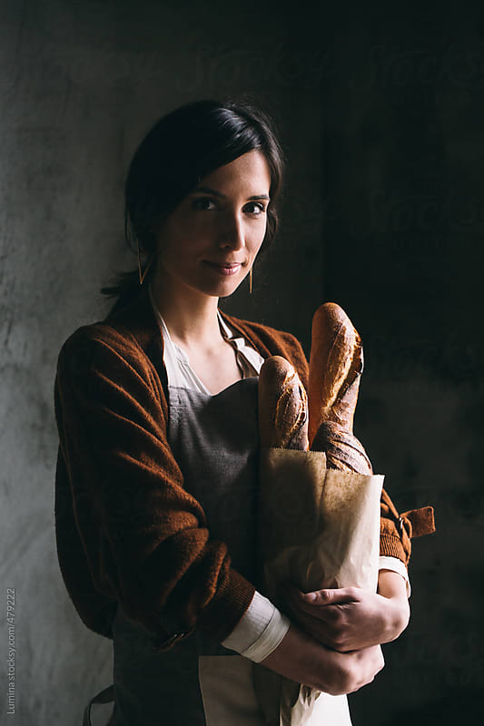 Woman With a Paper Bag Full of Bread by Lumina for Stocksy United