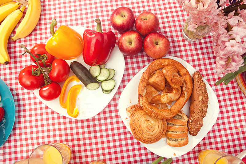 Table full of colorful breakfast picnic food. by Mosuno for Stocksy United