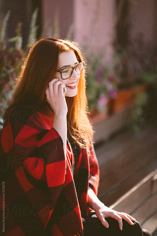 young woman on her cell phone by Vesna for Stocksy United