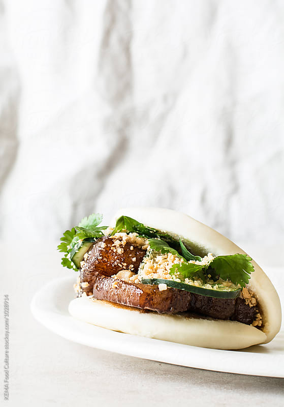 Pork belly bun  by KEMA Food Culture for Stocksy United