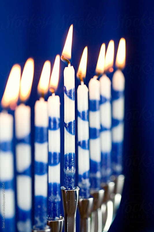 Hanukkah: Menorah with Lit Candles by Sean Locke for Stocksy United