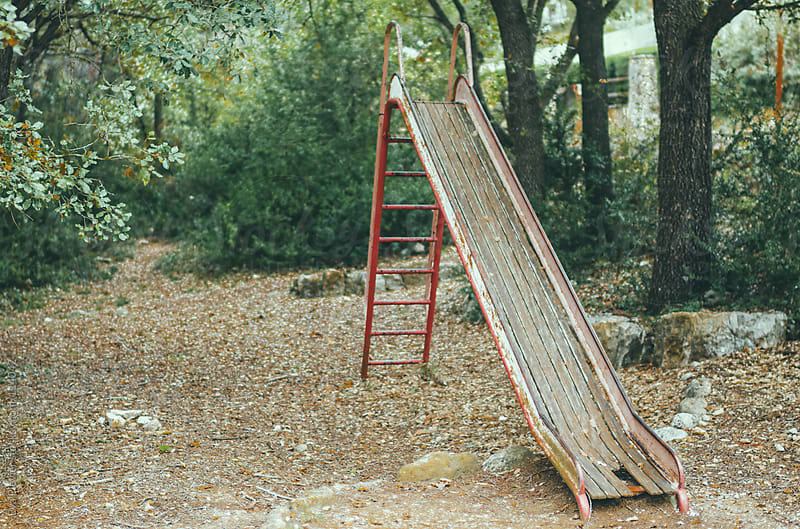 Abandoned slide in a park. by Eva Plevier for Stocksy United