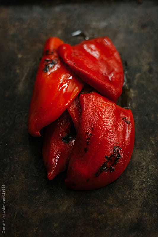 Roasted red peppers. by Darren Muir for Stocksy United