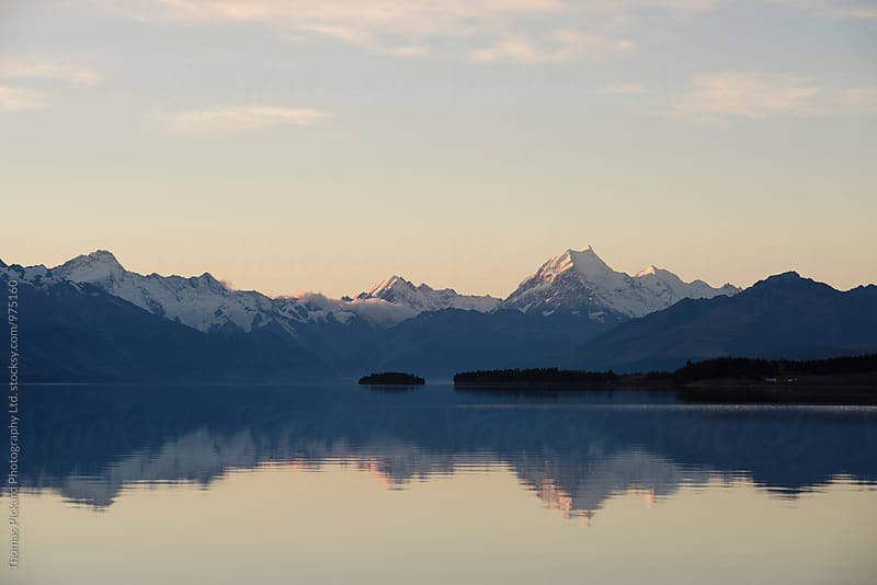 Aoraki / Mt Cook at dusk as seen across Lake Pukaki, New Zealand. by Thomas Pickard for Stocksy United