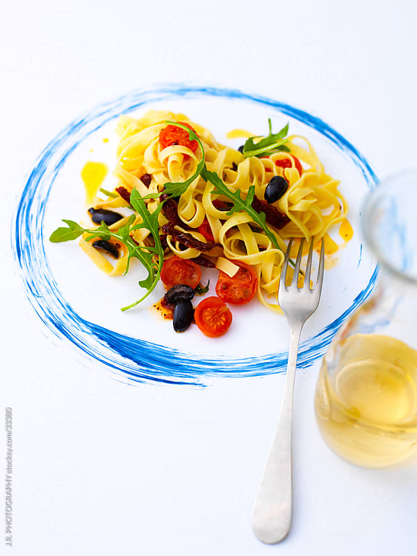 Tagliatelle pasta with wine by J.R. PHOTOGRAPHY for Stocksy United