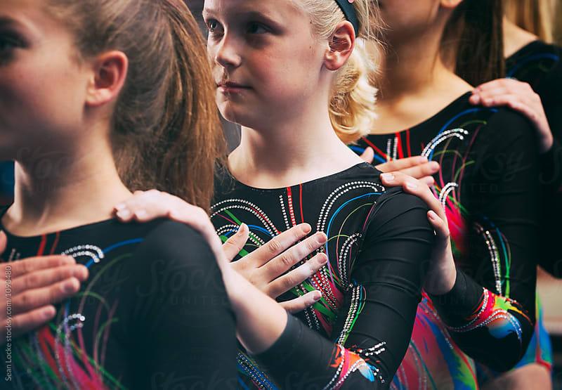 Gymnastics: Team In Line Saying Pledge Of Allegiance by Sean Locke for Stocksy United