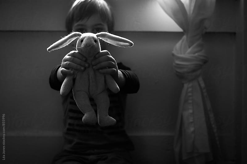 little boy hold a toy bunny by Léa Jones for Stocksy United