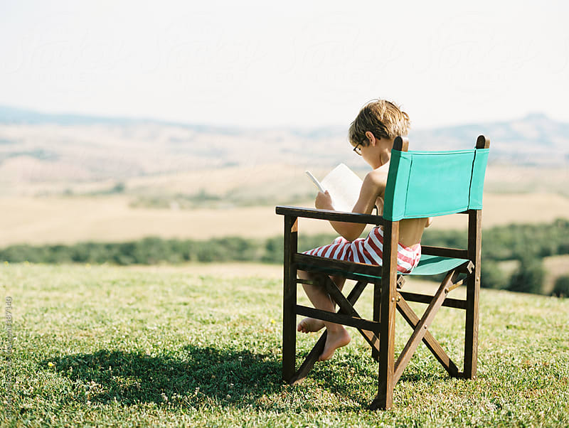 boy reading book in Italy by Kirstin Mckee for Stocksy United