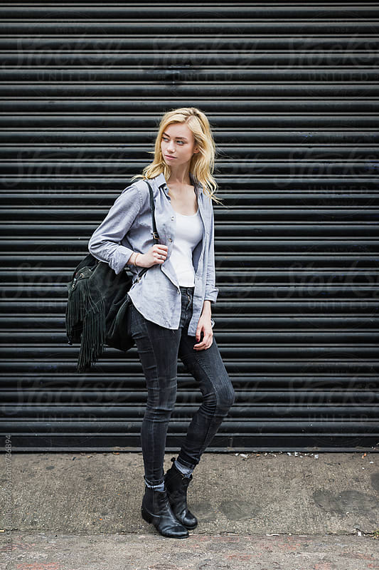 Young woman walking in the city by Mauro Grigollo for Stocksy United