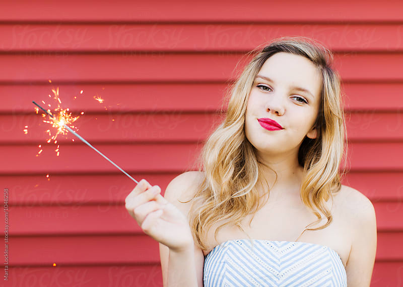 Teen with a Sparkler by Marta Locklear for Stocksy United