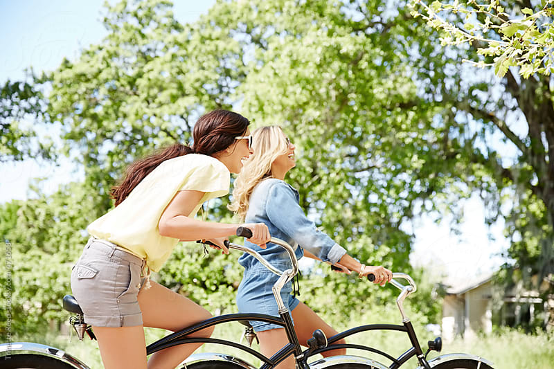 Girlfriends riding bikes and having fun in nature by Trinette Reed for Stocksy United