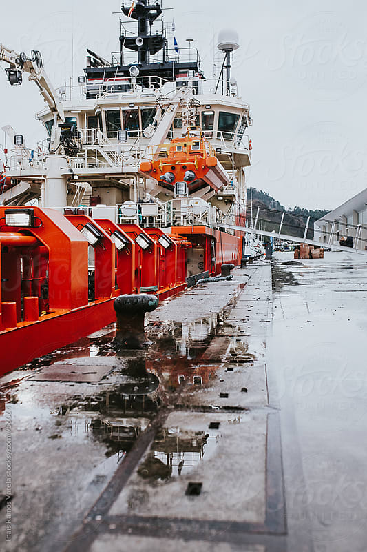 boat docked at the port by Thais Ramos Varela for Stocksy United