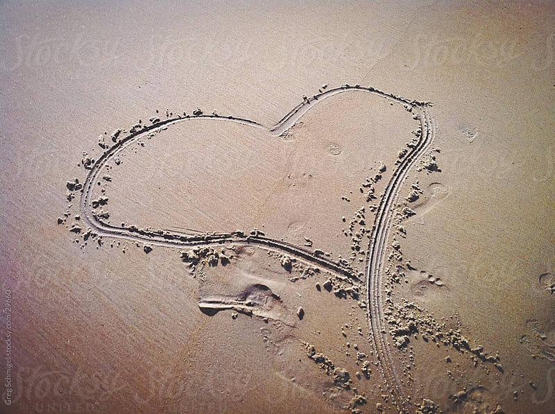 Heart drawing in sand by Greg Schmigel for Stocksy United
