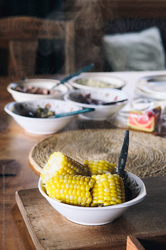 A bowl of steaming corn on the cob, New Zealand. by Thomas Pickard for Stocksy United