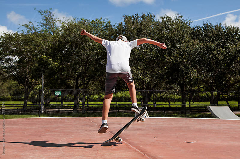 Boy Doing Skateboard Tricks by Stephen Morris for Stocksy United