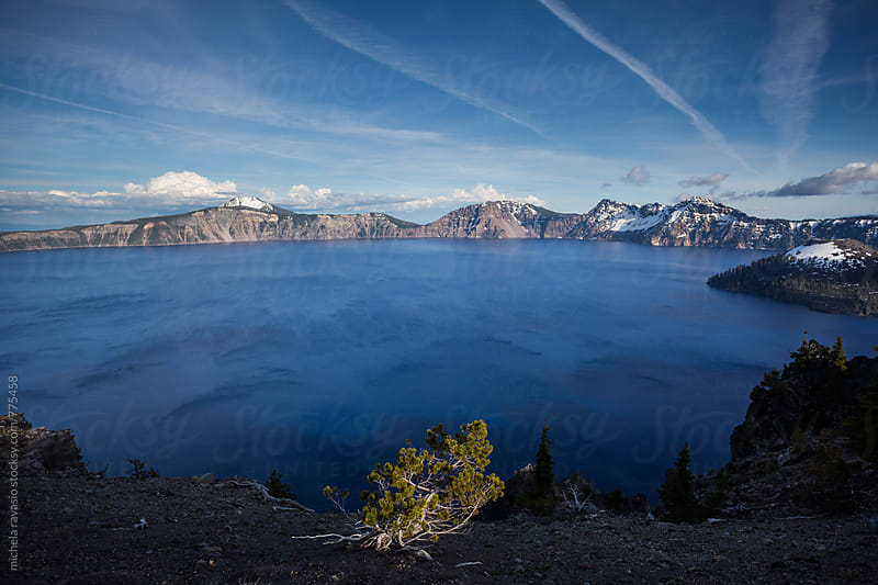 The blue lake in the Crater Lake National Park  by michela ravasio for Stocksy United