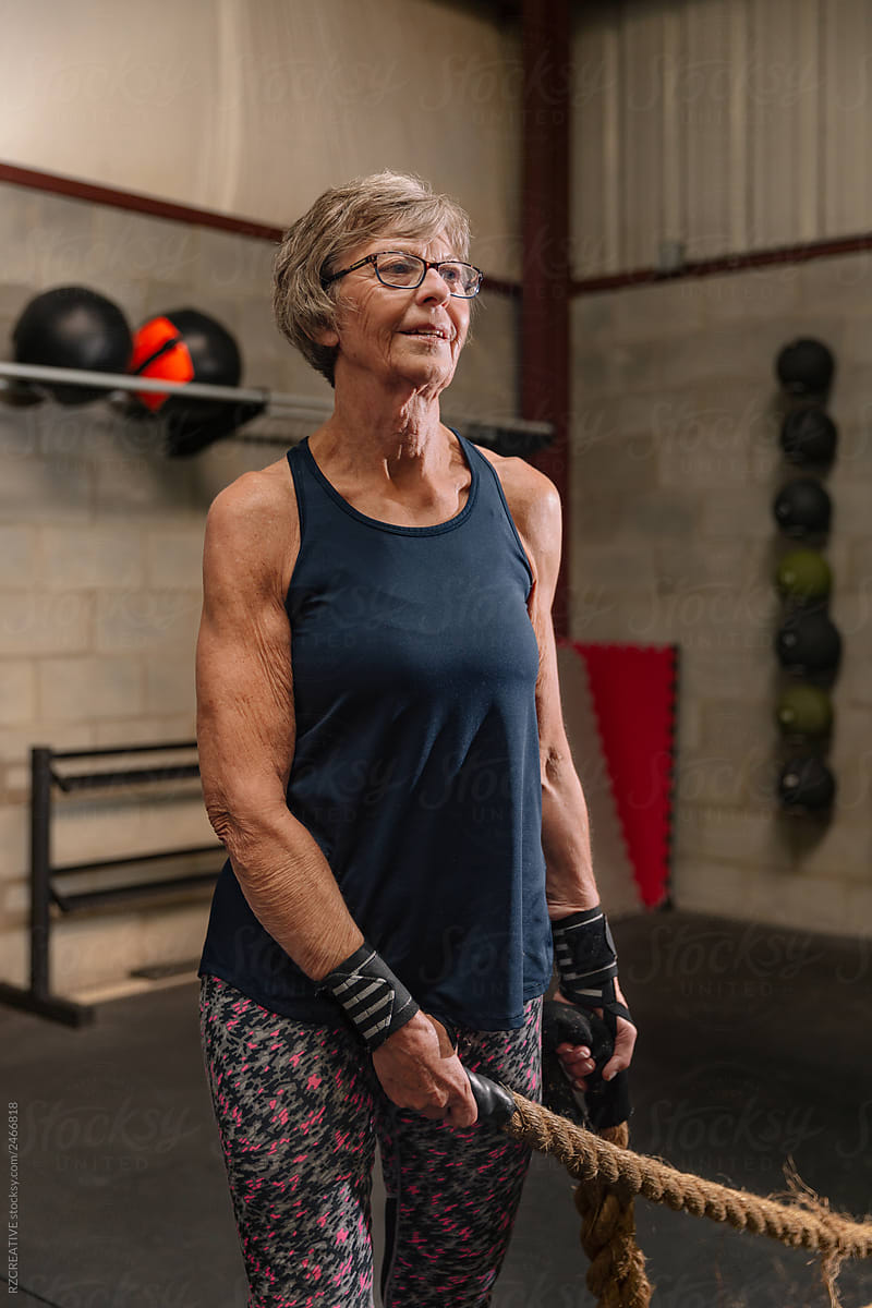 A Fit Mature Woman In Her Seventies Standing In A Gym