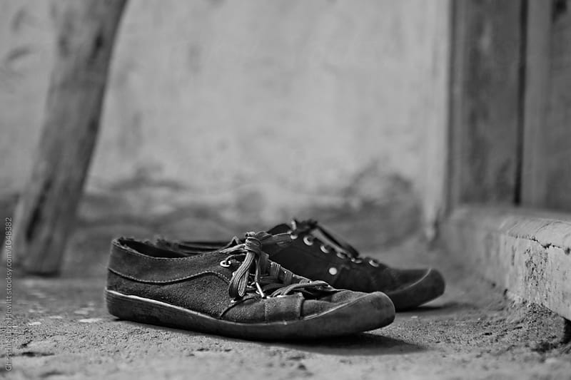 Shoes left outside of yoga class by Christine Hewitt for Stocksy United