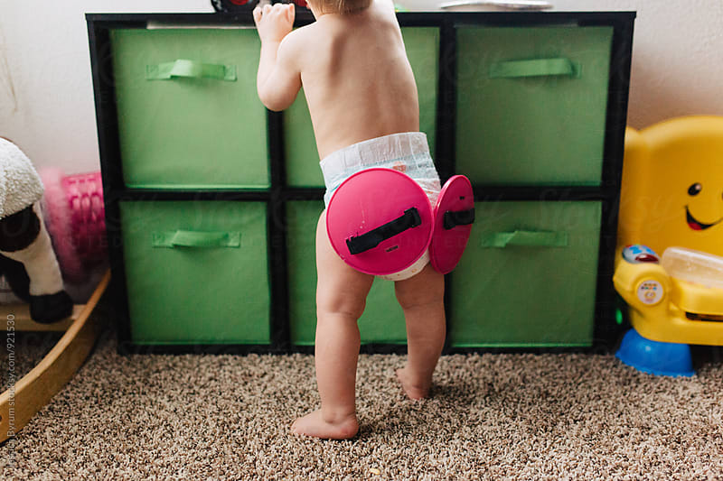 Child With Toy Stuck To Diaper by Jessica Byrum for Stocksy United