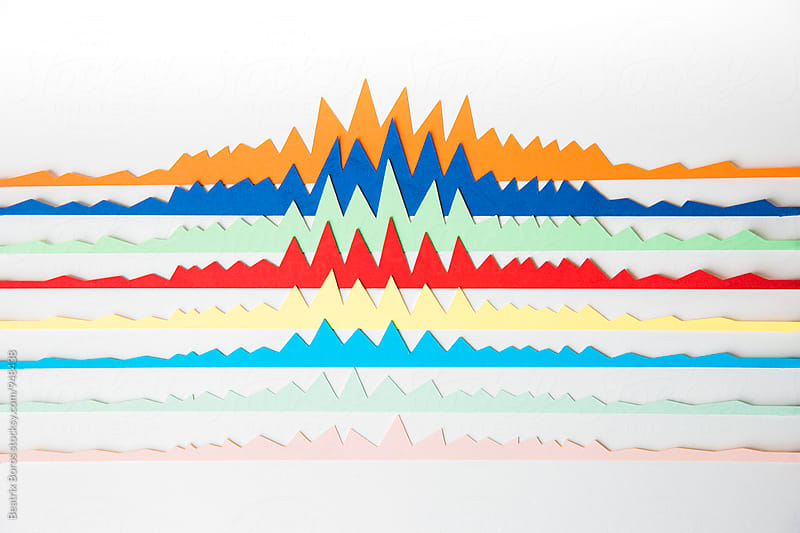 Colourful charts on white surface by Beatrix Boros for Stocksy United
