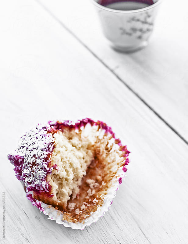 Raspberry and coconut muffin. by Darren Muir for Stocksy United