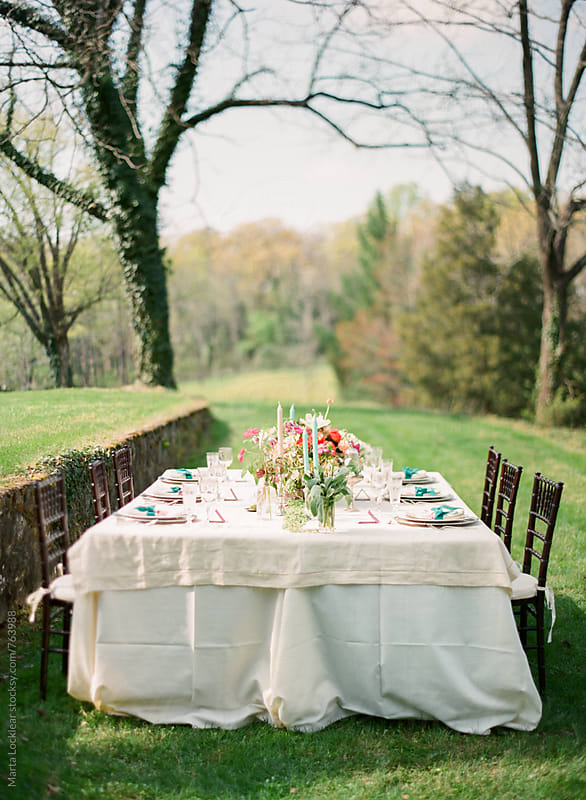 Garden wedding dinner table by Marta Locklear for Stocksy United