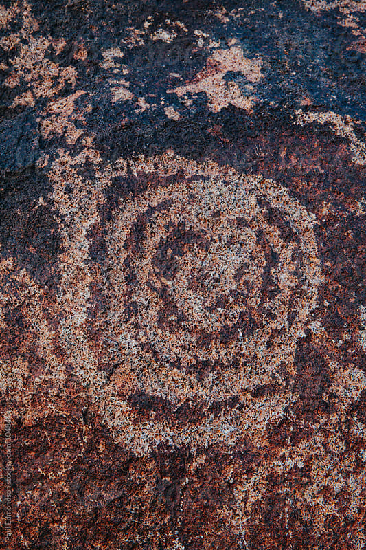 Close up of prehistoric petroglyph carvings on rock formations by Paul Edmondson for Stocksy United