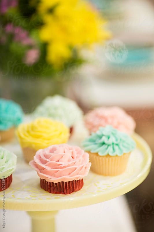 Delicious colorful muffins  by Maja Topcagic for Stocksy United