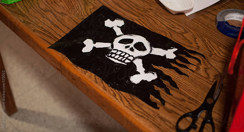 homemade pirate flag by Margaret Vincent for Stocksy United