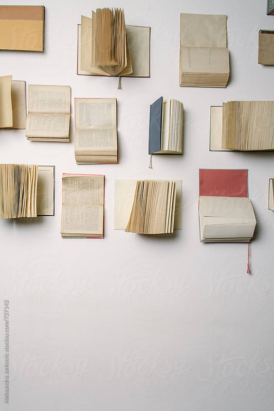 Old Books on the White Wall by Aleksandra Jankovic for Stocksy United