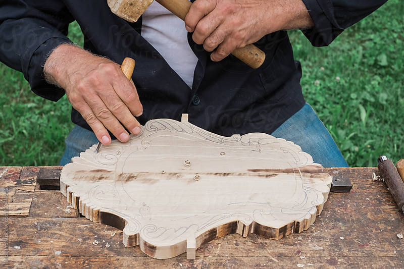 Anonymous Senior Man Carving Wood by Mosuno for Stocksy United