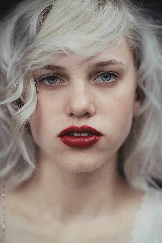 Artistic portrait of a beautiful young woman with blue eyes and hair by Jovana Rikalo for Stocksy United