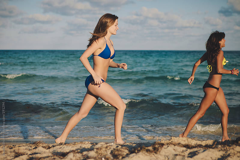 Two Sporty Young Women Running Along South Beach in Miami by Joselito Briones for Stocksy United