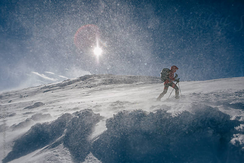 skiing in snowstorm by Peter Meciar for Stocksy United