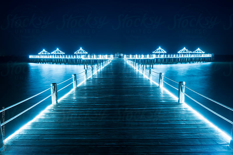 Gateway into sea with light in vacation resort by Lawren Lu for Stocksy United