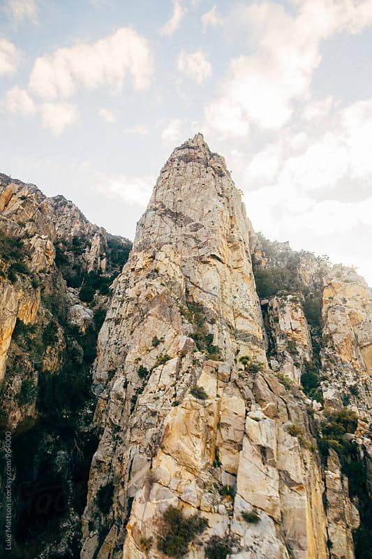 Rock Pillar On Side Of Desert Mountain by Luke Mattson for Stocksy United