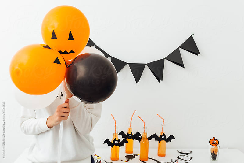 Woman Holding Halloween Balloons by Katarina Radovic for Stocksy United
