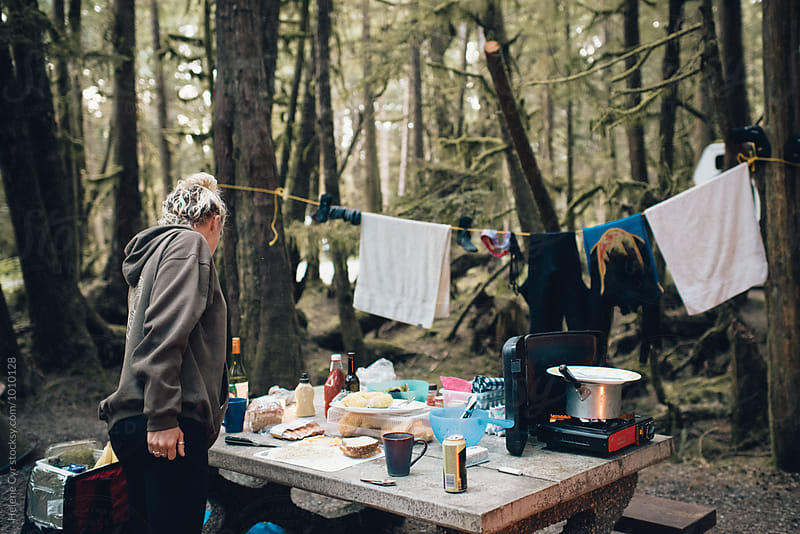 Camping in the woods by Helene Cyr for Stocksy United